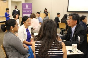 Lee Ho, right, assistant commissioner for the Minnesota Department of Health, discusses possible career opportunities and community collaborations during a speed networking round.