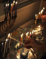 Lighting hanukah candles together