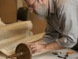 Rabbi Druin sewing the AARC torah, March 29, 2016. Photo by Stephanie Rowden