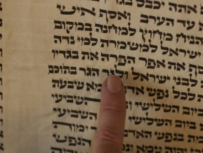 Rabbi Druin points to another distinctive embellishment to the letter pey in the AARC torah.