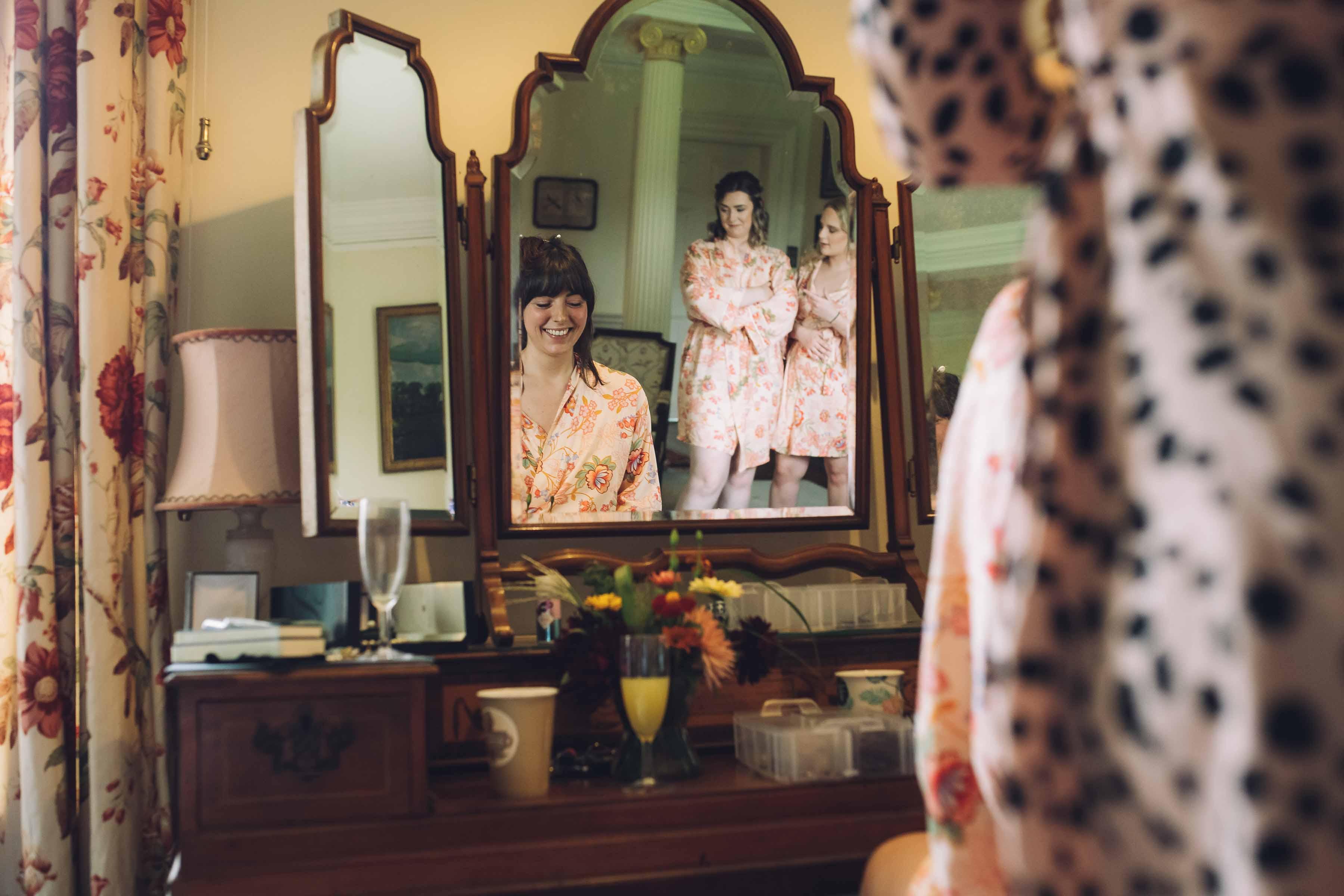 Bridesmaids in Mirror with Bride