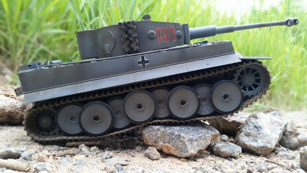 Color photograph of dark grey model Tiger tank going over some stones Aaron David Yeoman Author