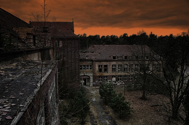 dark colored photograph of abandoned sanatorium
