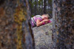 Ella Resting On A Rock Along Storm Pass