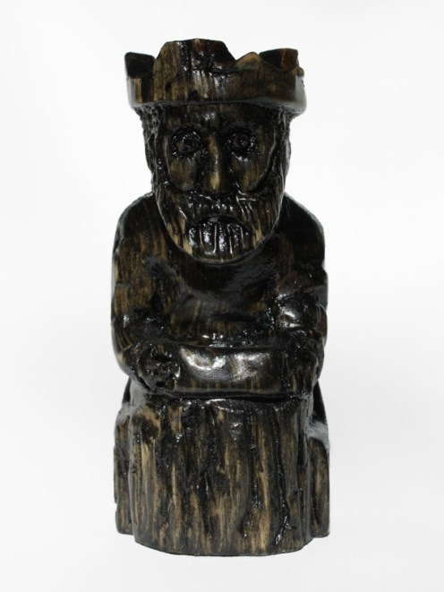 Black King. Carved, stained, and varnished pine. 2012.