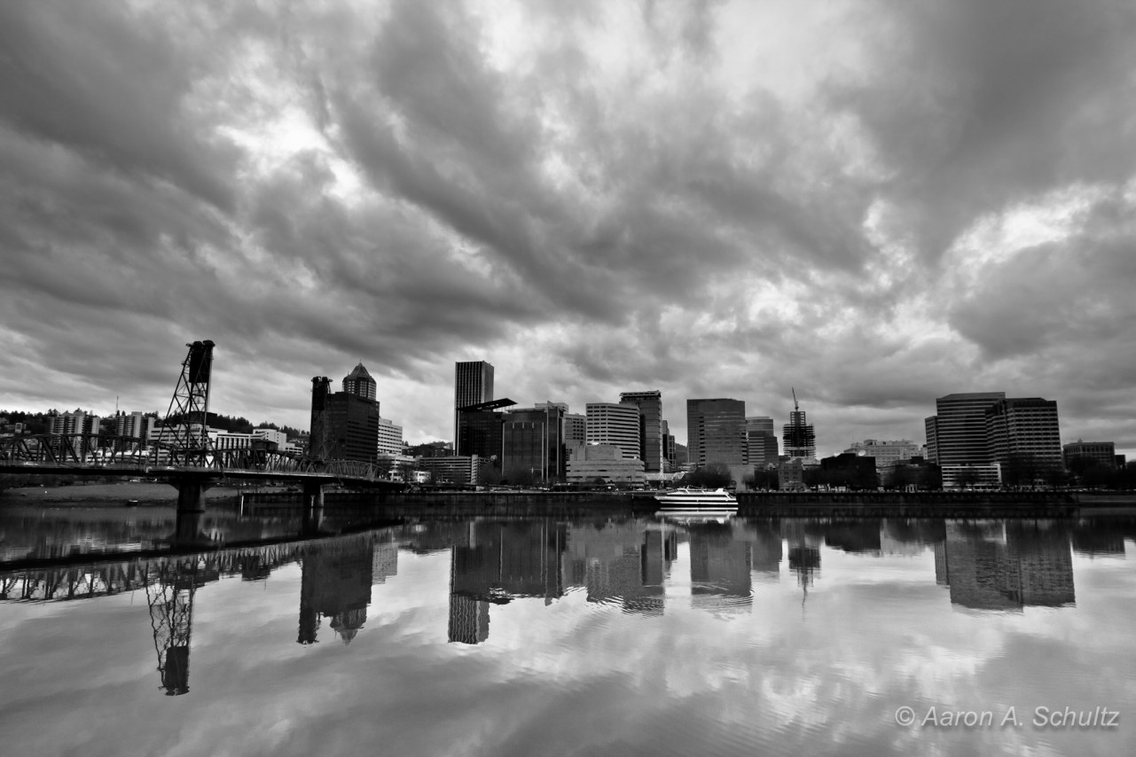 downtown portland reflects off the willamette river in black and white