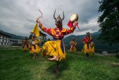 Costumed monk performs traditional dance in Tsechu festival at Thimphu, Bhutan.