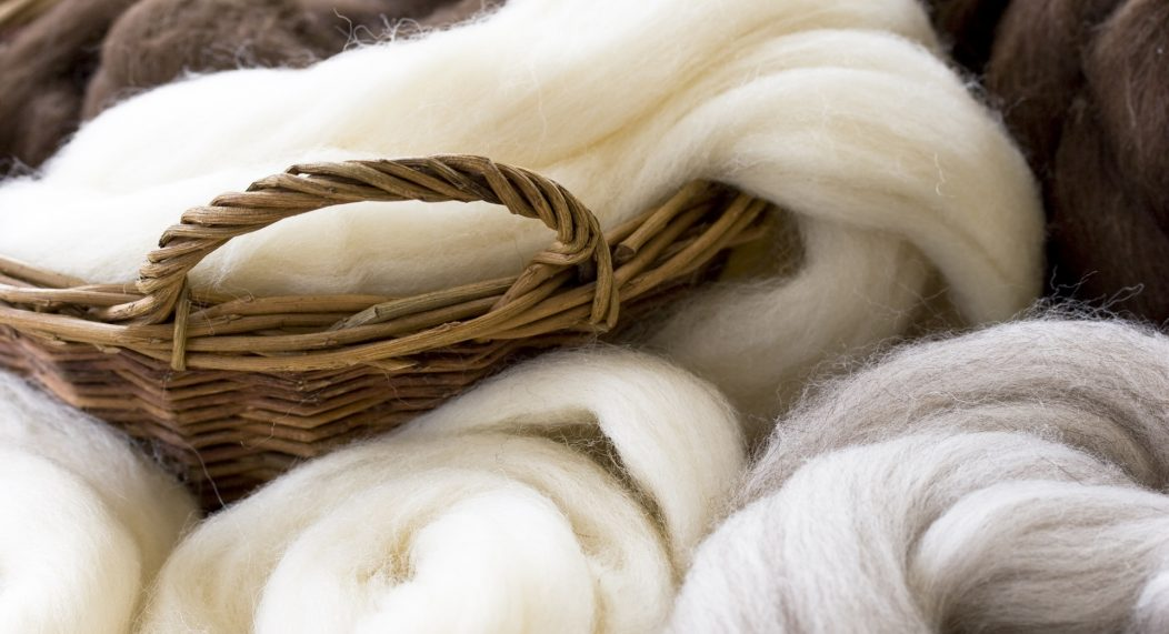 Natural wool fibres in basket, shallow DOF.