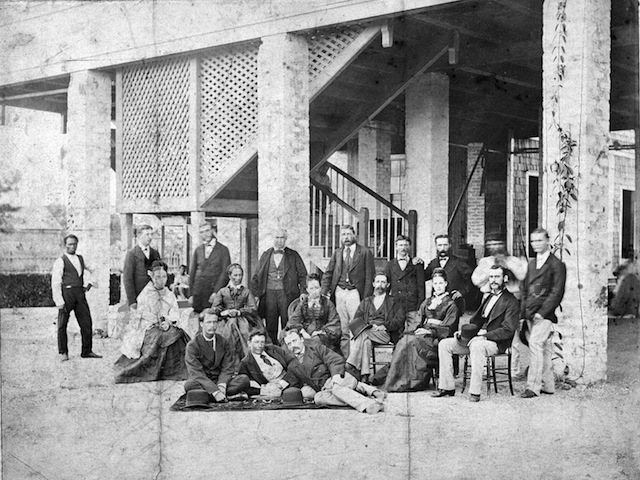 A photograph taken outside the Great House at the Enmore plantation in Giuana, c1876, where Sujaria had worked. Courtesy John Platt