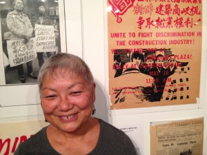 Lisa Yee was involved in the protests at Confucius Plaza, documented in the poster on the wall next to her. Photo by Esther Wang.