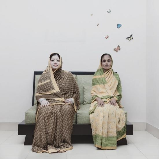 57-year-old housewife Anjumanara (left) with 50-year-old Jibonunneesa, who works as a home servant in Anjumanara 's house in Green Road, Dhaka.