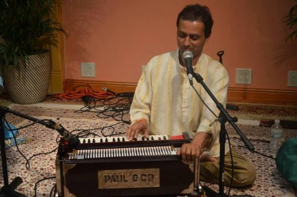 Mindra Sahadeo at home with one of his harmoniums (Photo: Nanda Sahadeo)
