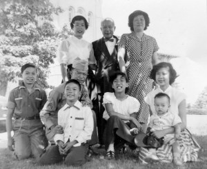Pearl (standing L) with parents and siblings and other relatives at Queens College, 1953.