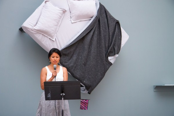 Muna Gurung reads at the Queens Museum on August 30. Photo by Preston Merchant