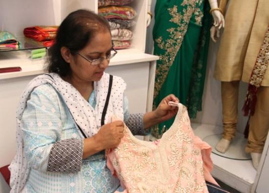 Nasreen holding a kurta top.