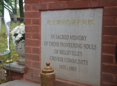 """The inscription on the gravestone that says, """"Cantonese in the Arms of Jesus""""."""