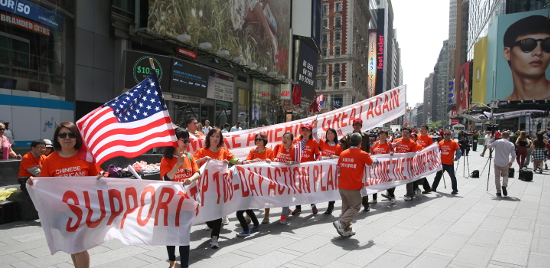 Trump supporters rally at Times Square on April 29 to express support for Trump's first 100 days. Photo by Mike Hong