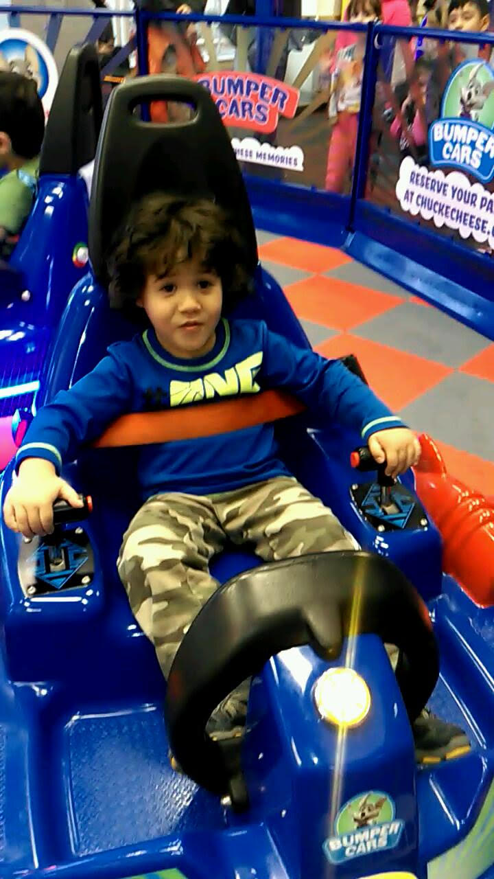 My son on the bumper cars at Chuckie Cheese
