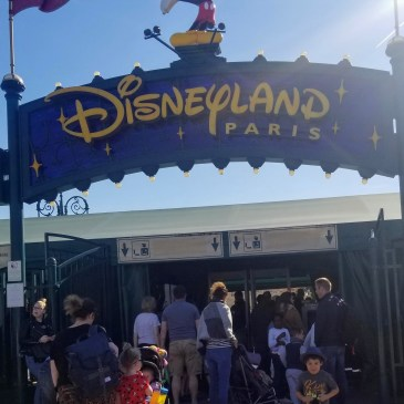 Xavier in front of the Disneyland Paris sign May 2019