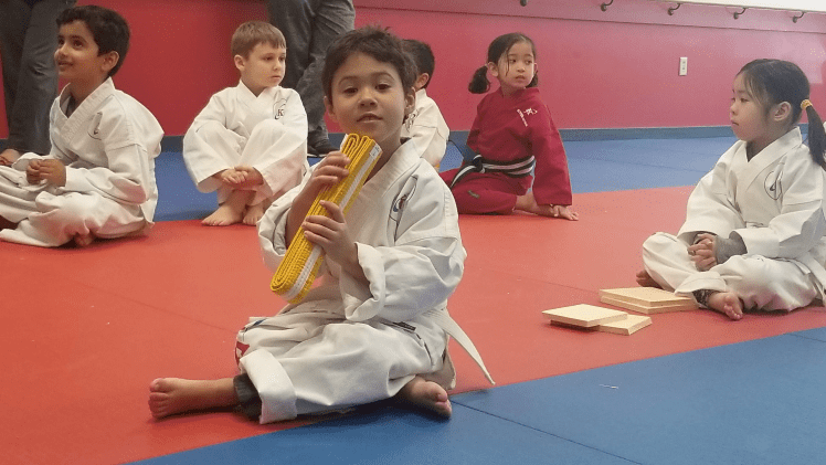 my son getting his yellow belt karate