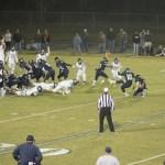 Bo Cunningham kicking a fieldgoal