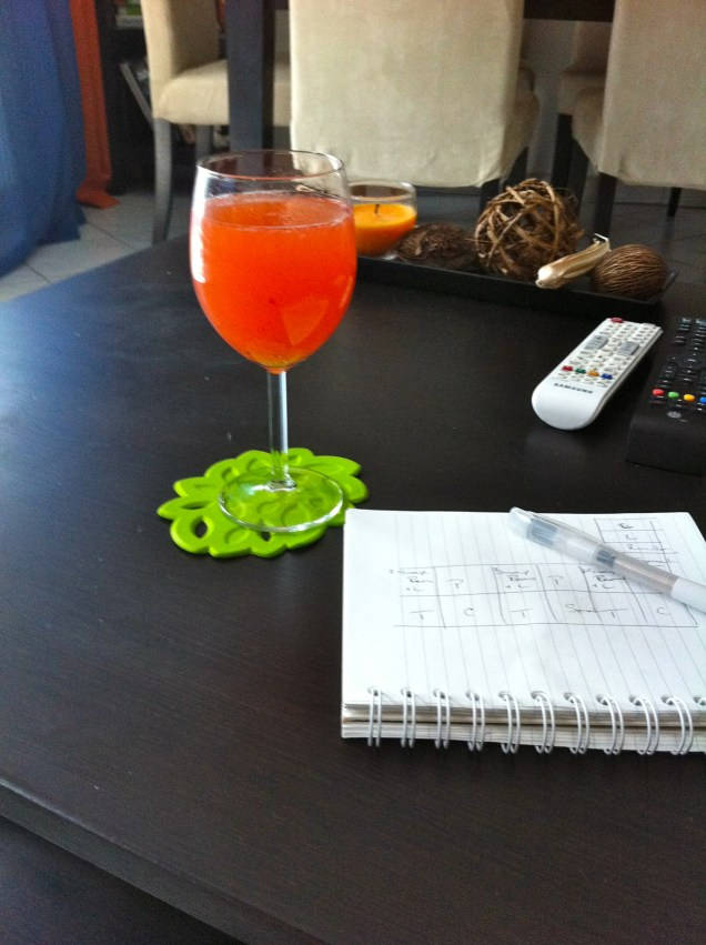 Planning next year's garden while enjoying the taste of summer - a strawberry spritzer: 1/4 glass of syrup, 1/4 glass of white wine, & the rest filled with cold sparkling water. Prost!