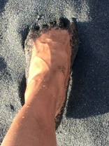 Experiencing the uniqueness of black sand - so very different from the white and pink sand beaches I know from home.