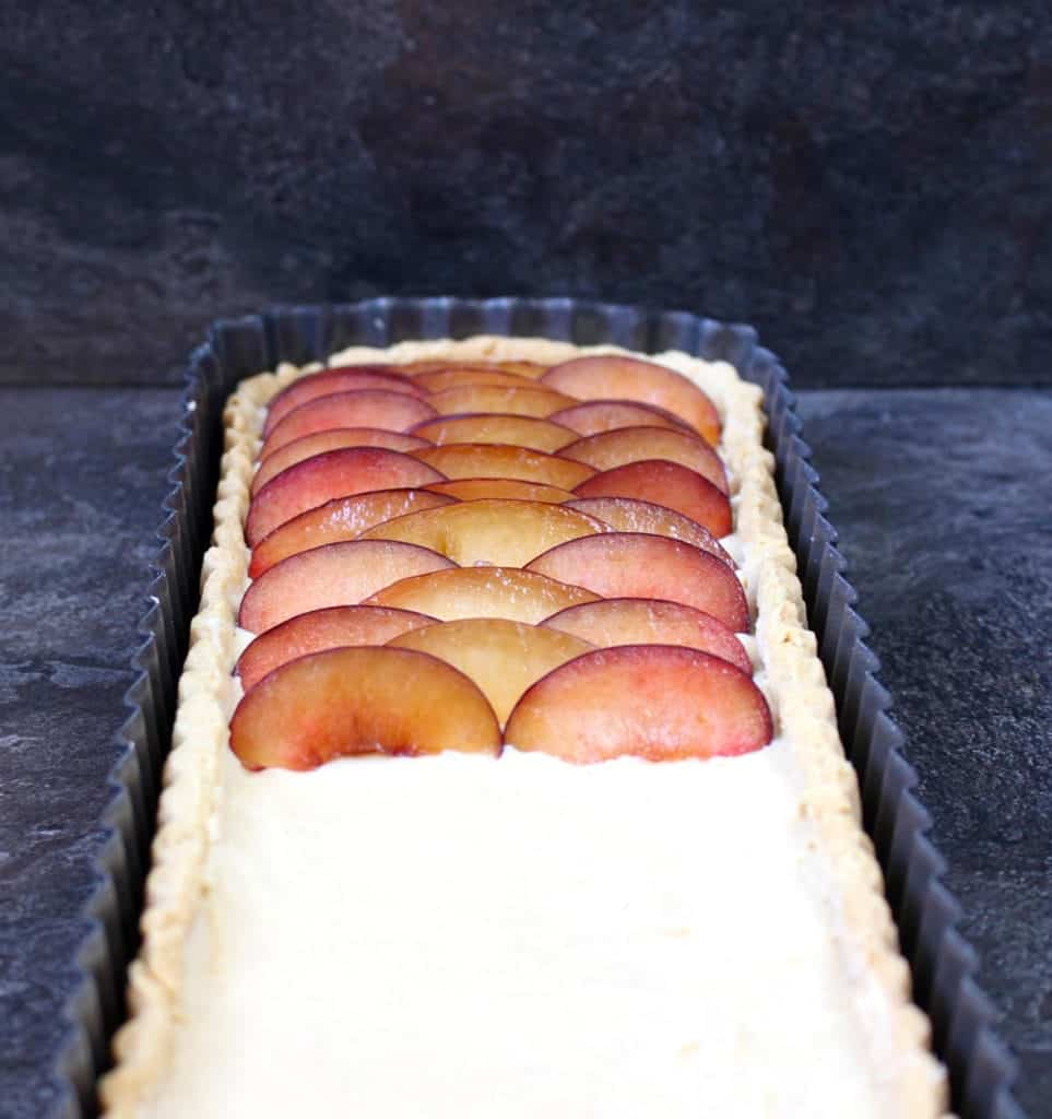 Half of the plums placed over the pastry cream