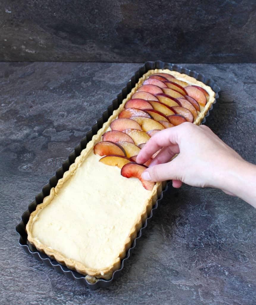 Placing the plums over the vanilla custard