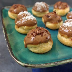 Close up on Coffee Choux Buns on a green plate