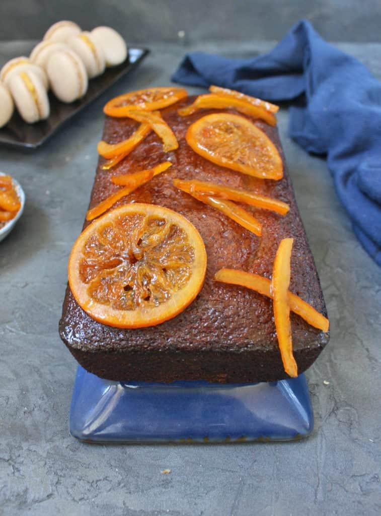 Close up on the candied oranges over the glazed cake