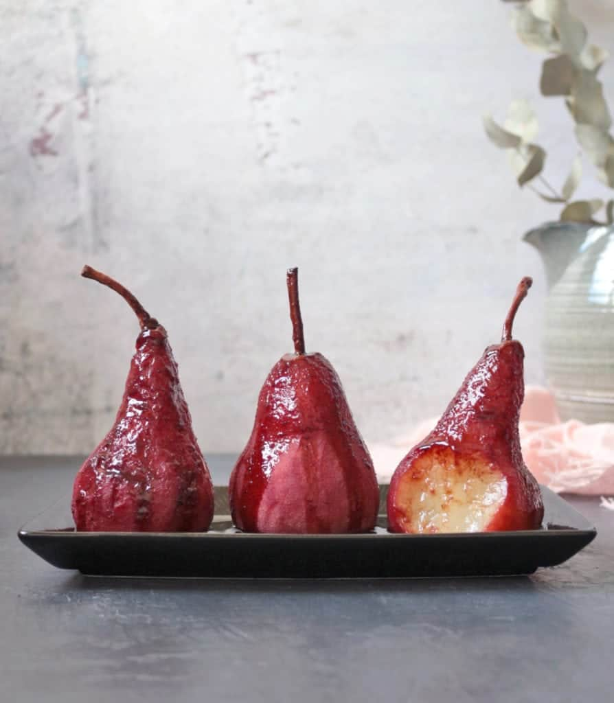 3 Pears poached with red wine reduction poured over