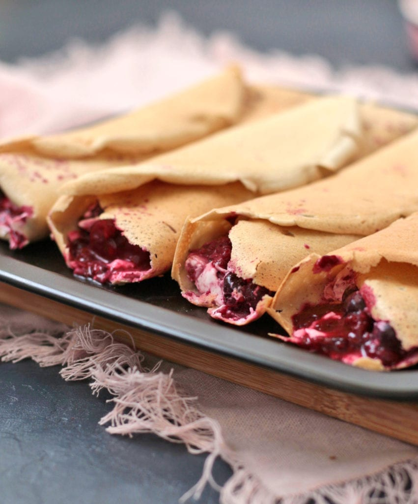 Crepes filled with berry compote - close up