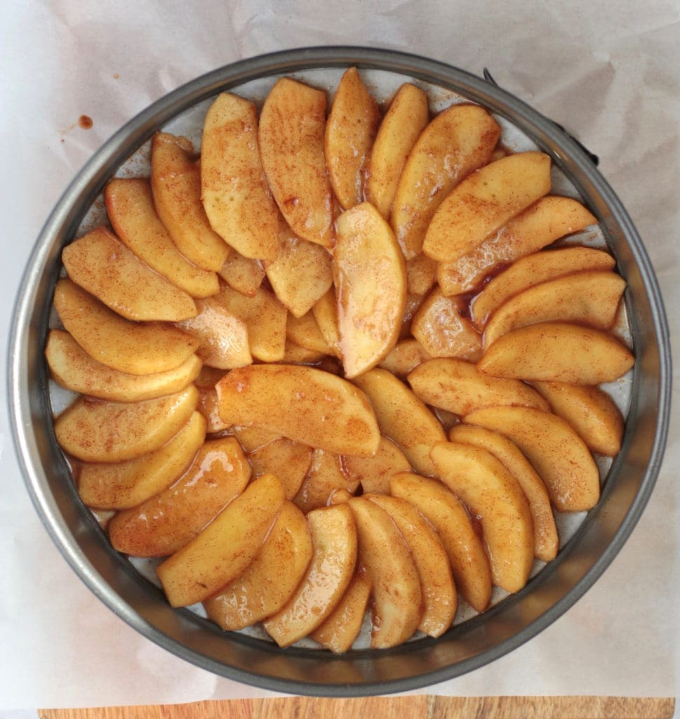 Process Shot: assembling the caramelised apples at the bottom of the cake pan.