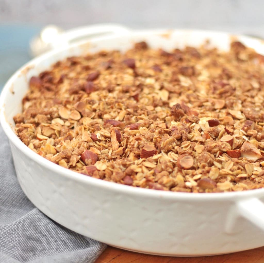 Close up on the baked crumble in a white ceramic dish