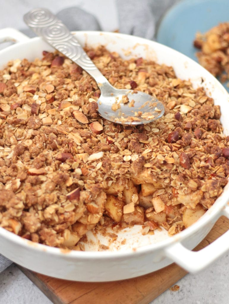 Baked Crumble with a spoon taken off and silver serving spoon