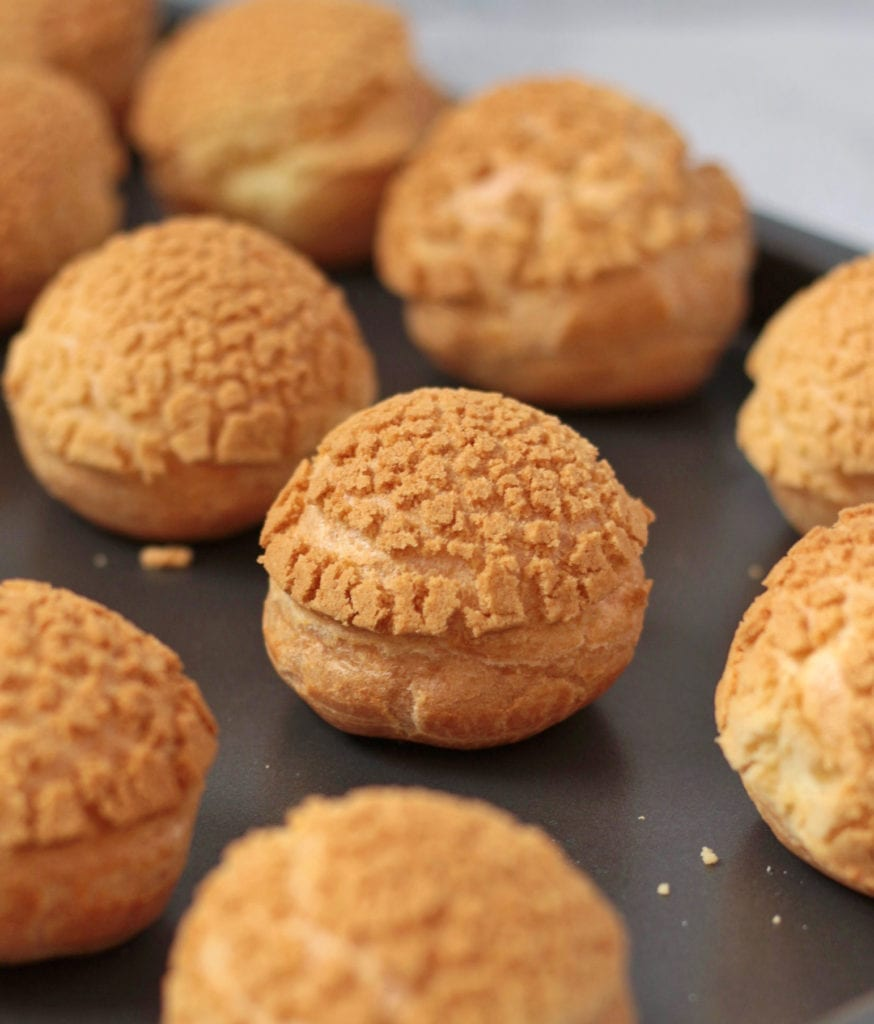 Baked Choux au Craquelin coming out of the oven