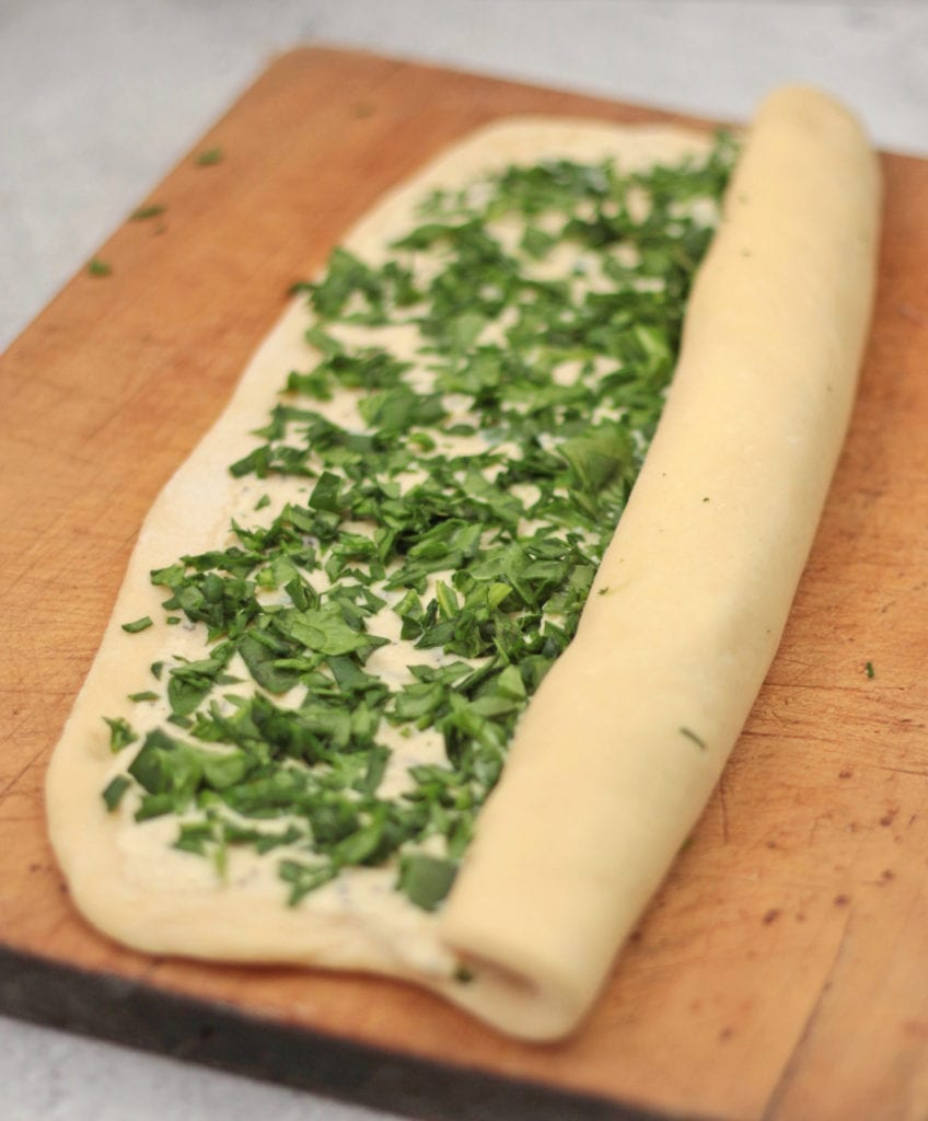 Roll the bread dough over the filling
