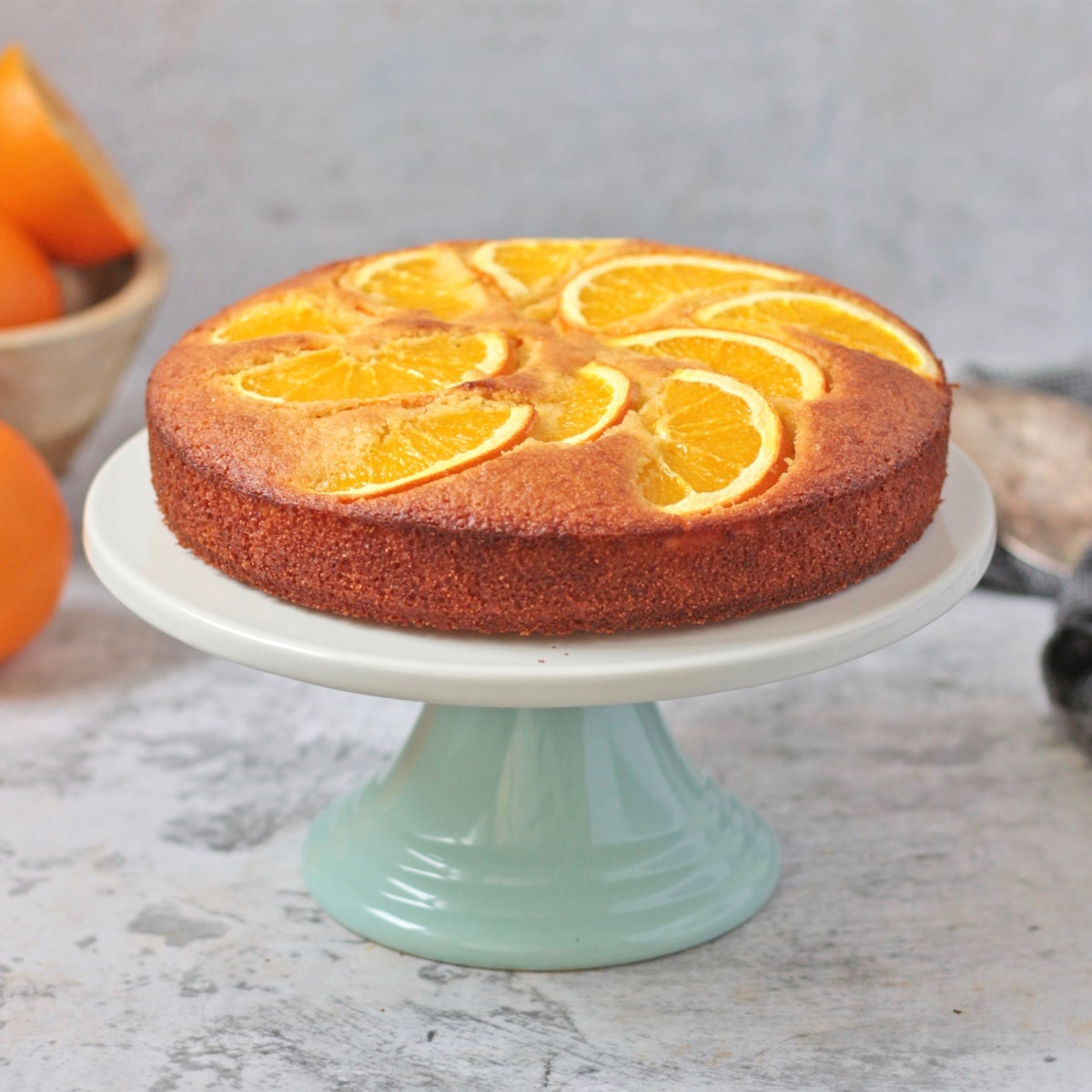 Semolina Cake on a white and green cake stand