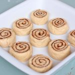Unbaked rolls in a white ceramic dish
