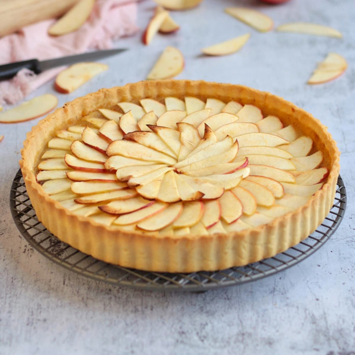 Apple tart on a round cooling rack