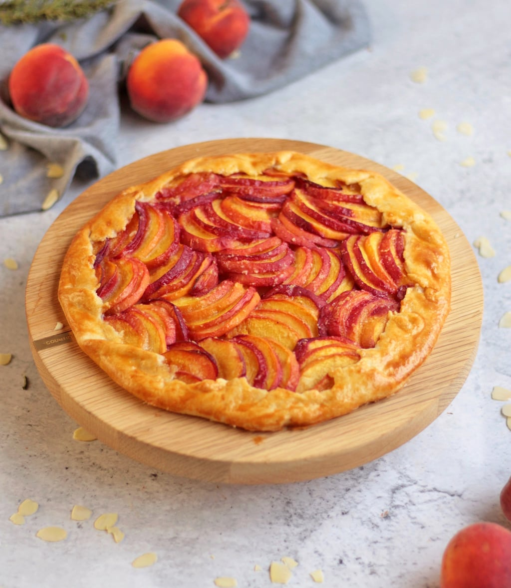 Full Peach Galette on the wooden cake stand