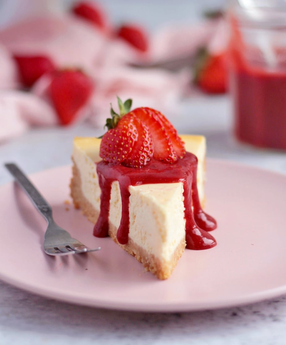 Cheesecake topped with the Strawberry Sauce.