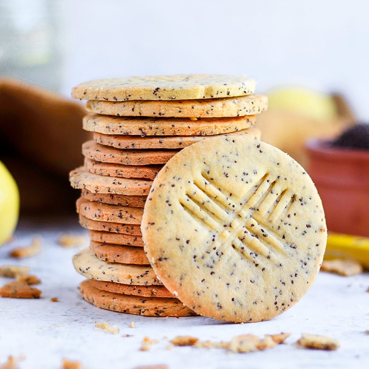 One cookie leaning on a stack of shortbread