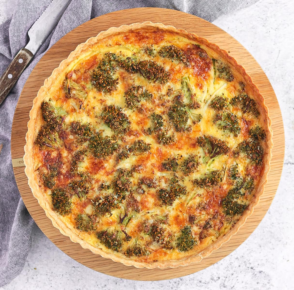 Broccoli Quiche from above on a wooden board