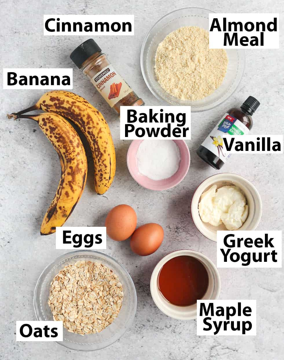 Muffins Ingredients on a grey surface.