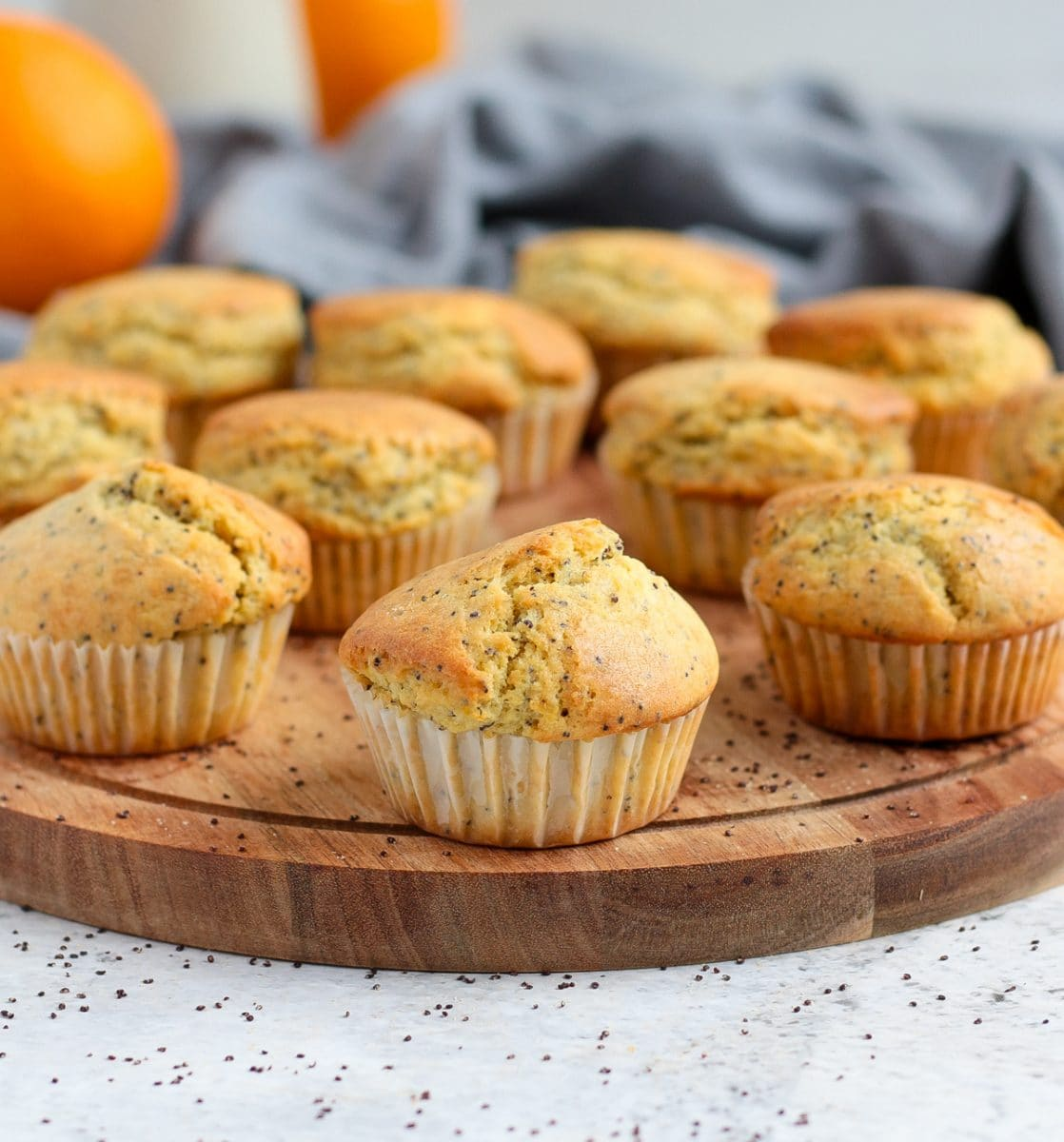 Baked muffins placed over a round wooden board