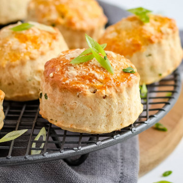 Close up on one scone topped with chopped spring onion