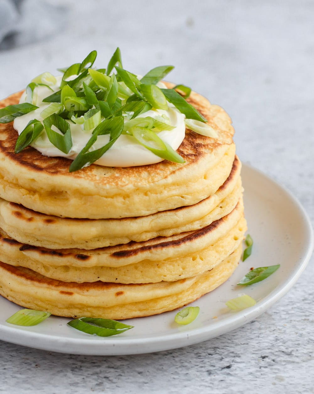 Pancake Stack topped with Sour Cream and Spring Onions