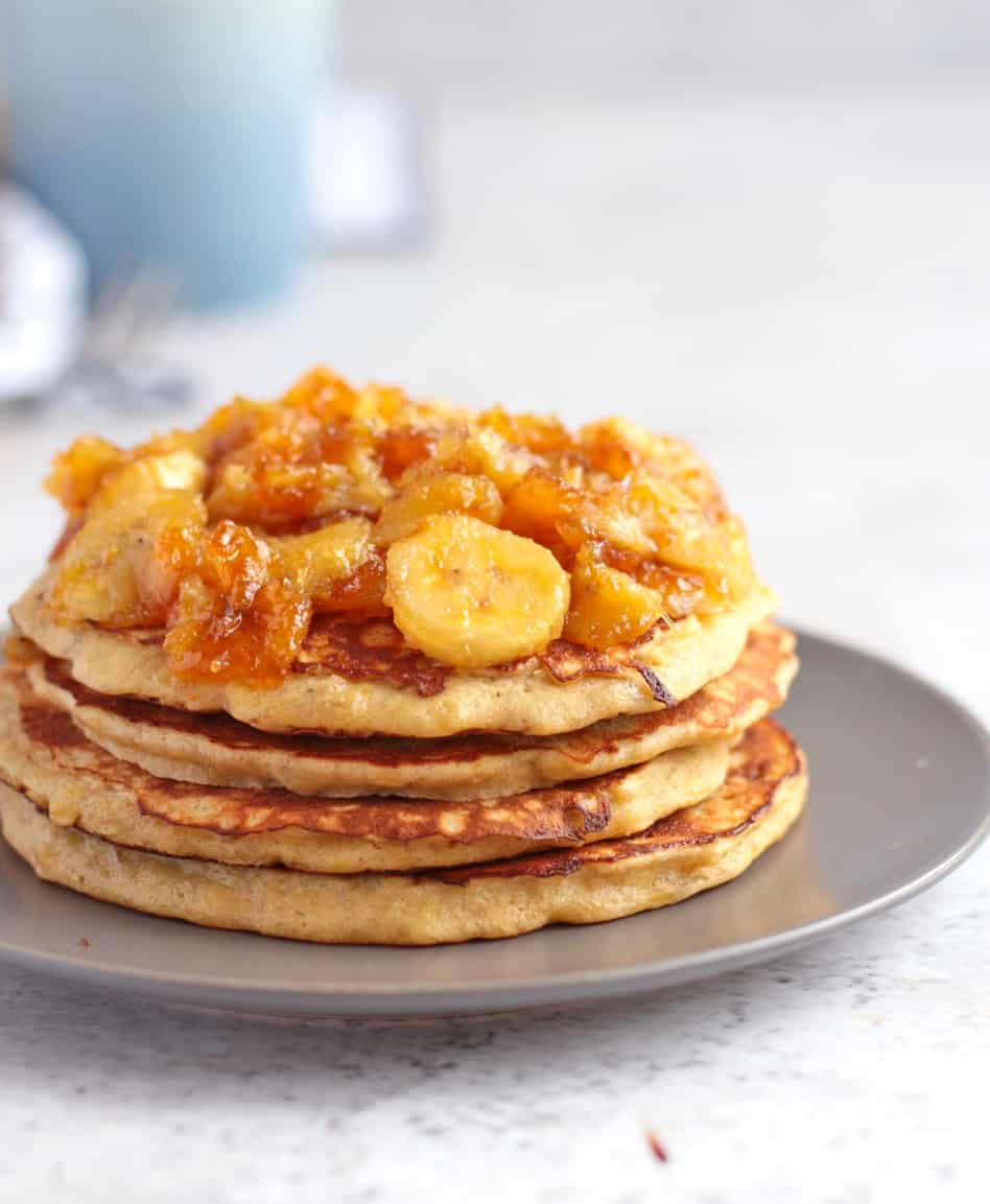 Close up on the side of the pancakes topped with the caramelised banana topping.